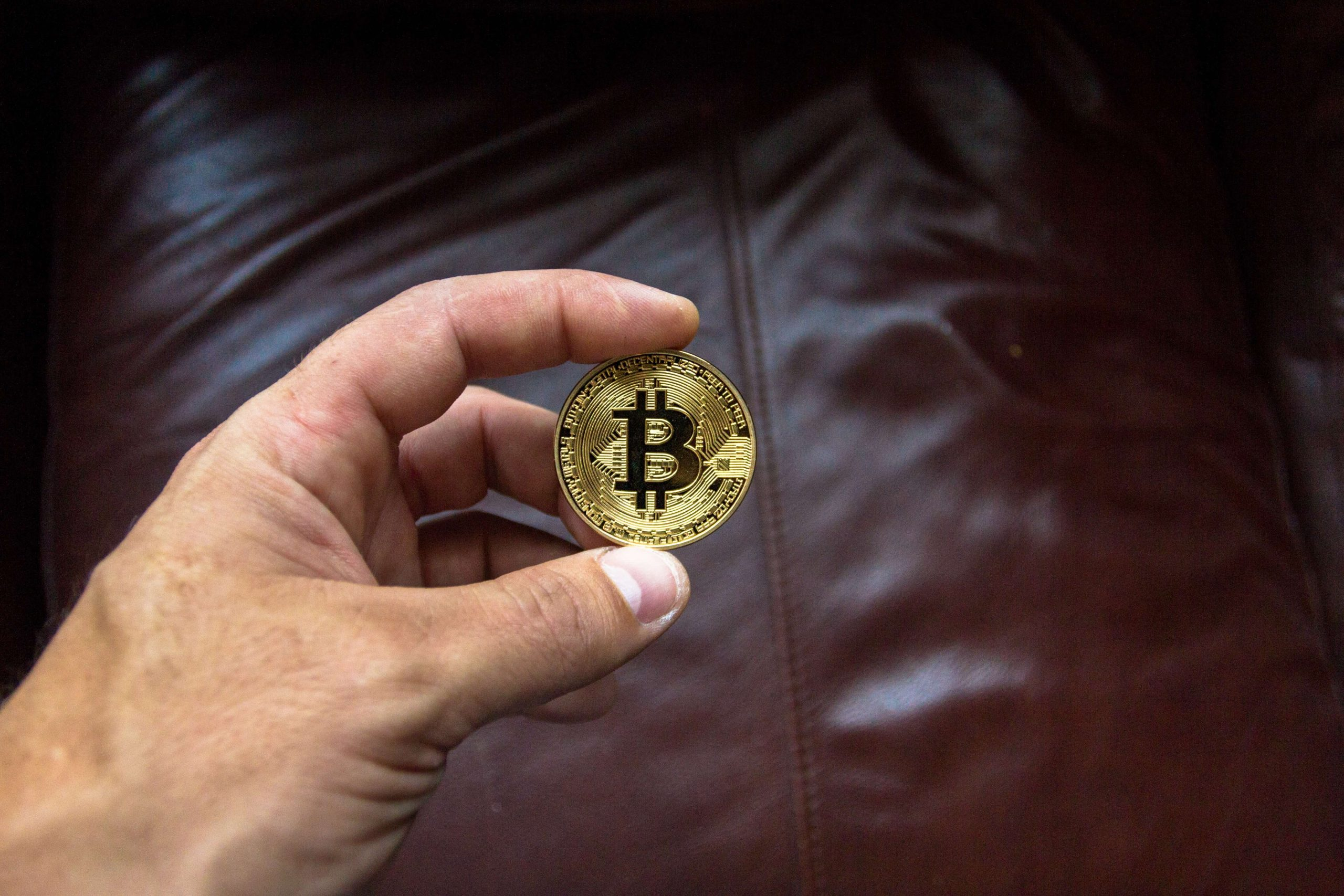 round-gold-colored-and-black-coin-on-person-s-hand-bitcoin_formula-post